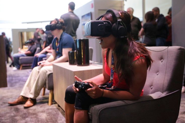 People try out the Oculus Rift virtual reality headsets at the Oculus booth at the Electronic Entertainment Expo on Wednesday, June 11, 2014, in Los Angeles. (AP Photo/Jae C. Hong)